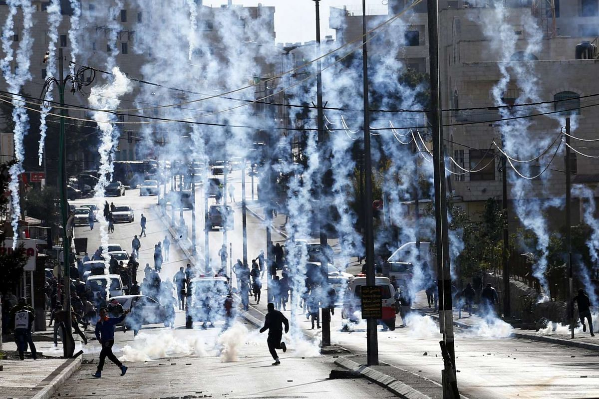 An Israeli borderpolice vehicle shooting tear gas at Palestinians during clashes on the outskirts of the West Bank city of Bethlehem, on Dec 18, 2015.