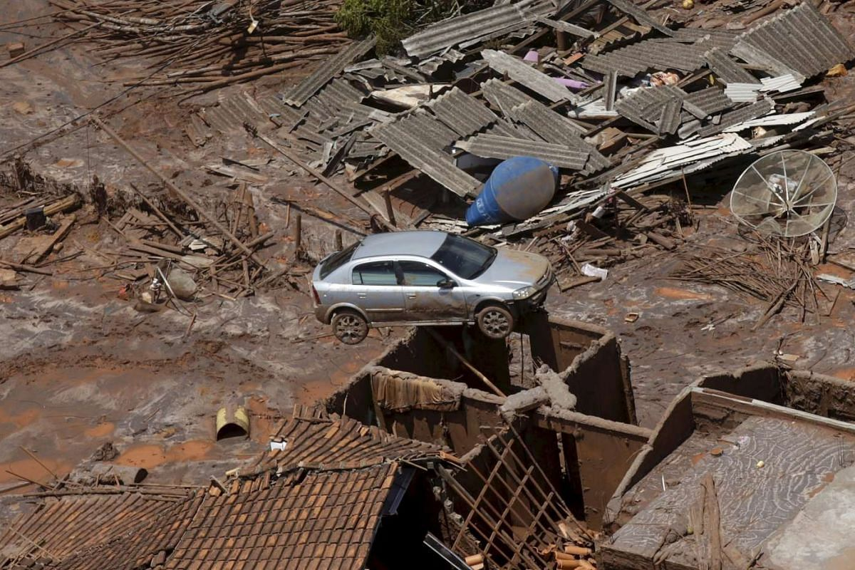 Debris is pictured in Bento Rodigues district which was covered with mud after a dam owned by Vale SA and BHP Billiton burst, in Mariana, Brazil, on Nov 10, 2015.