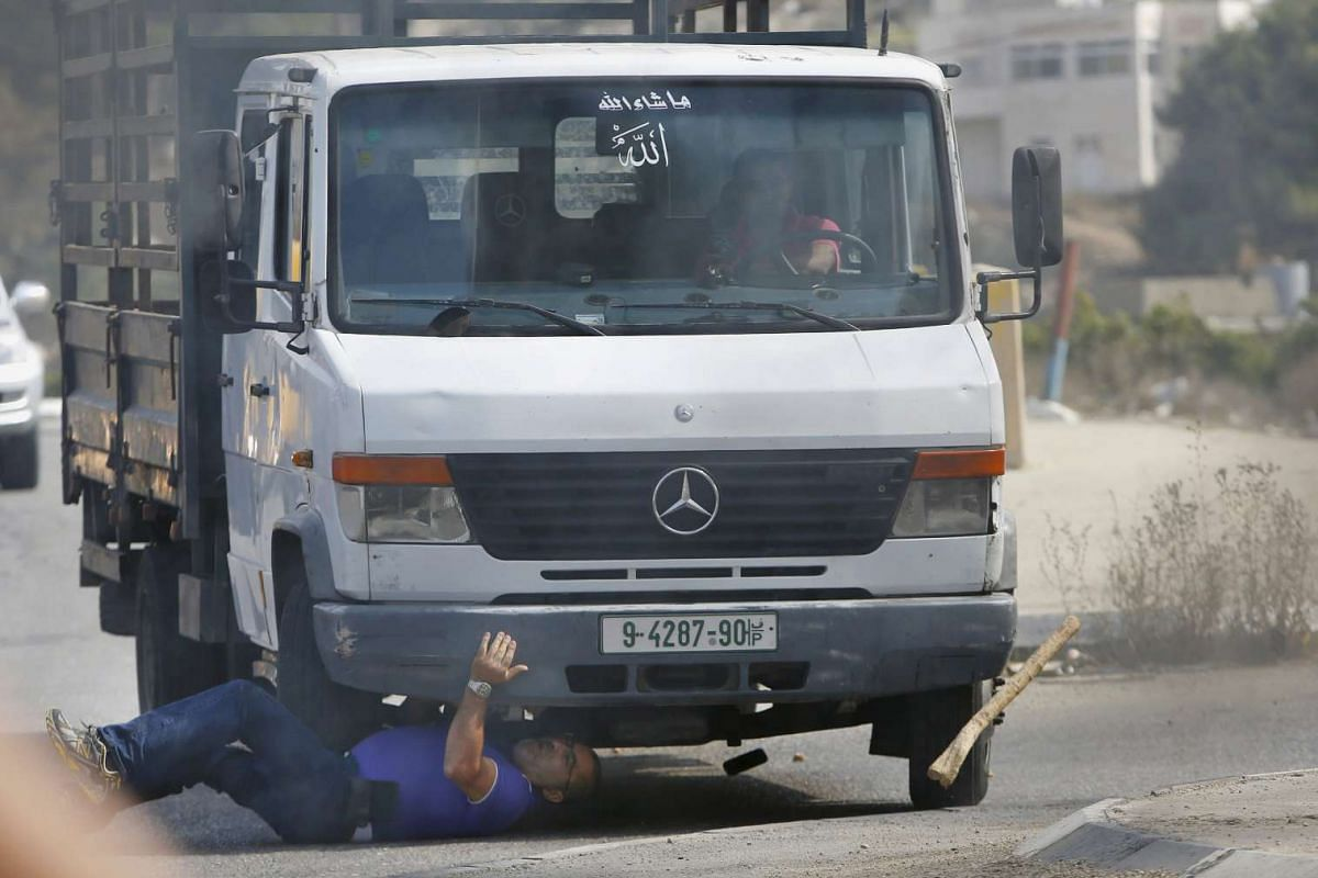A Palestinian vehicle striking an Israeli motorist, who later died, in the West Bank city of Hebron on Oct 20, 2015.