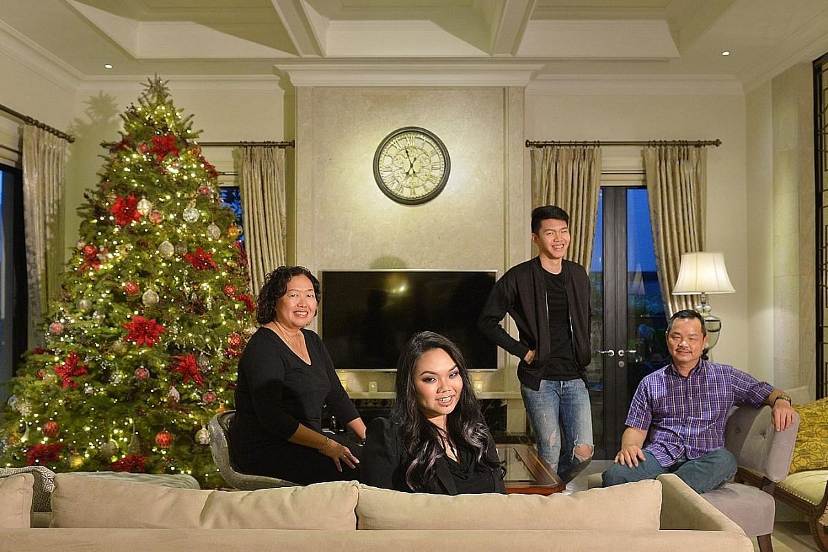 Ms Laura Ong (from far left) in the living room of her semi- detached house in Serangoon Garden with daughter Andrea, son Joshua and husband Max Lee.
