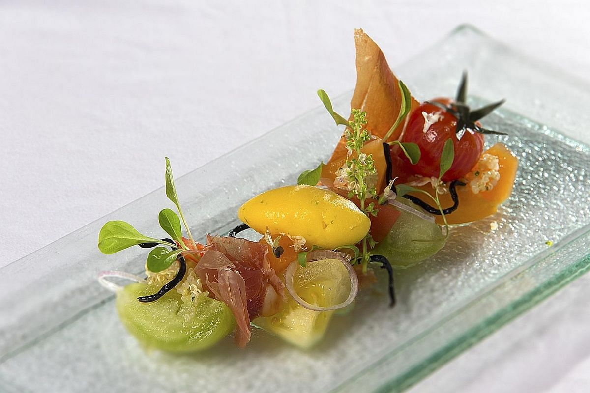 Collection Of Heirloom Tomatoes (above) comprises premium tomatoes with frozen honey lemon dressing and shavings of Serrano ham.