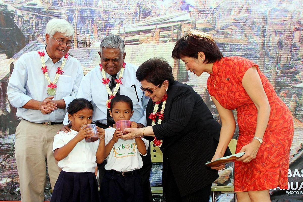 Asian social hero Tony Meloto (left) with former Singapore President S R Nathan, Mrs Nathan, nutritionist Aileen Leong and two Filipino children at a Singapore-built village for needy Filipinos in 2007.