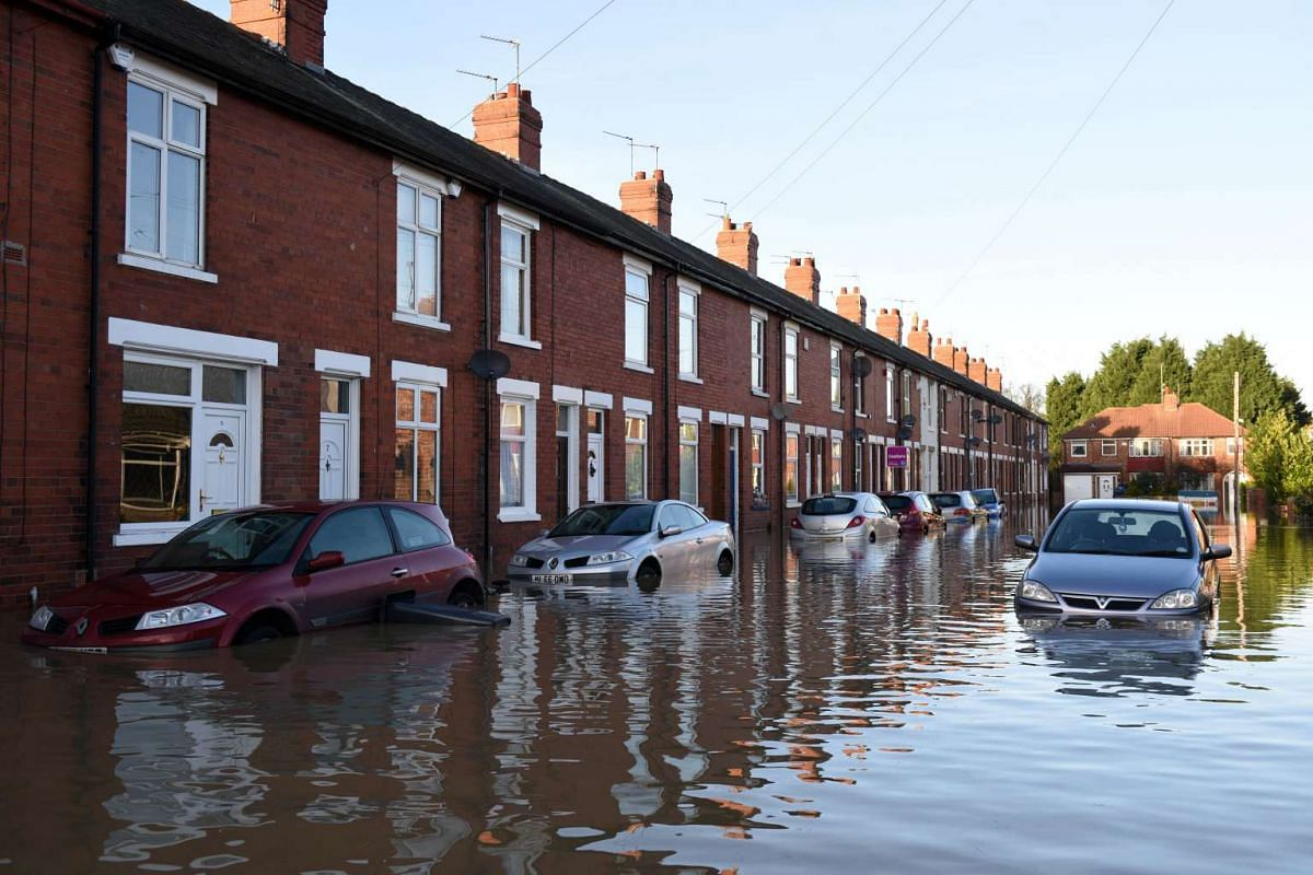 FLOODS IN ENGLAND: A flooded residential street adjacent to the River Foss which burst its banks in York, northern England, on Dec 27, 2015.