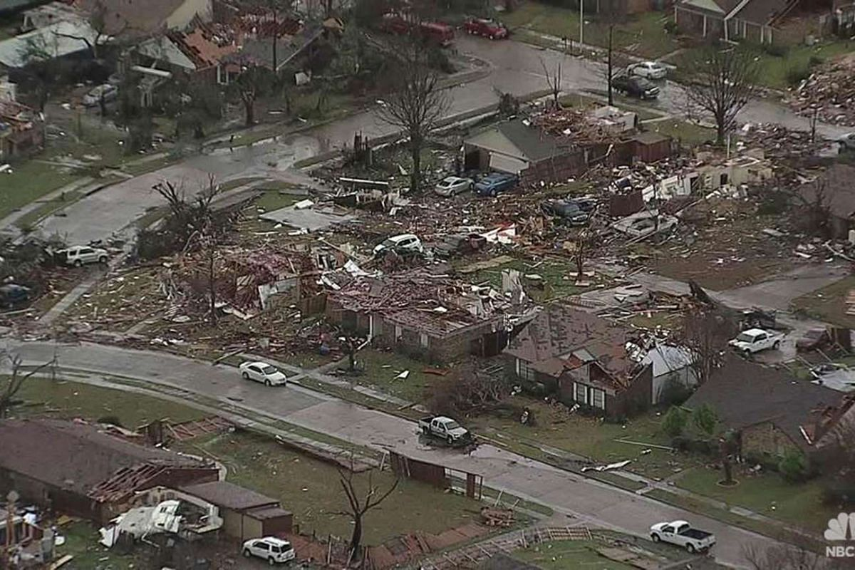 STORM IN US: An aerial image from a video courtesy of NBCDFW.com showing houses and vehicles damaged by a tornado in Rowlett, Texas, on Dec 27, 2015.
