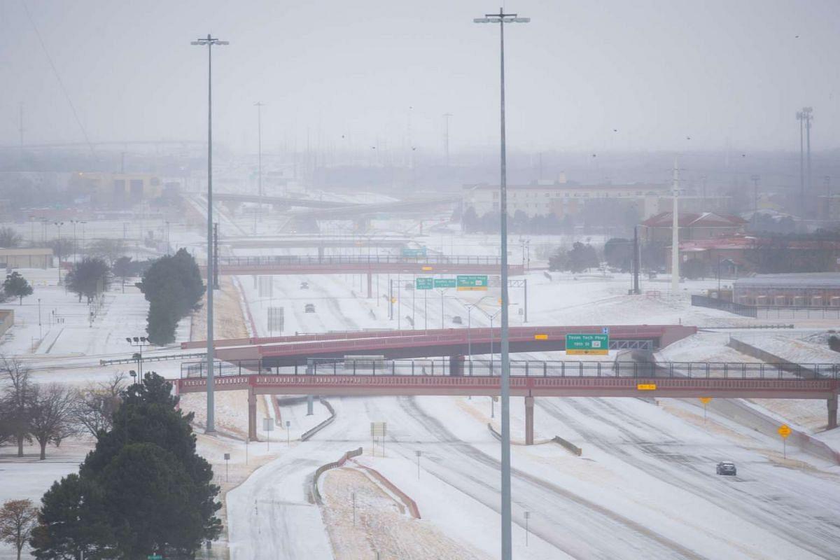 STORM IN US: Snow blanketing Marsha Sharp Freeway on US Highway 82 on Dec 27, 2015, in Lubbock, Texas.