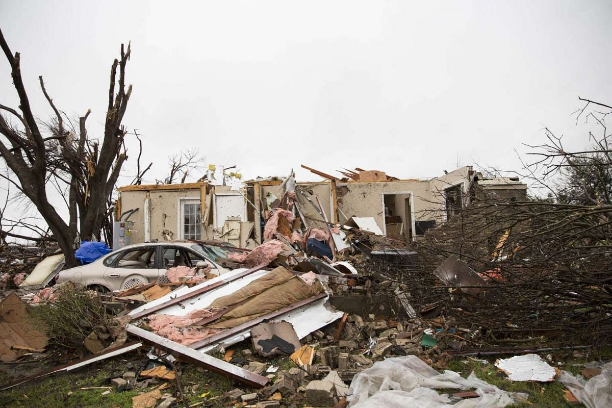 STORM IN US: A heavily damaged area is seen on Dec 27, 2015, in the aftermath of a tornado in Rowlett, Texas.