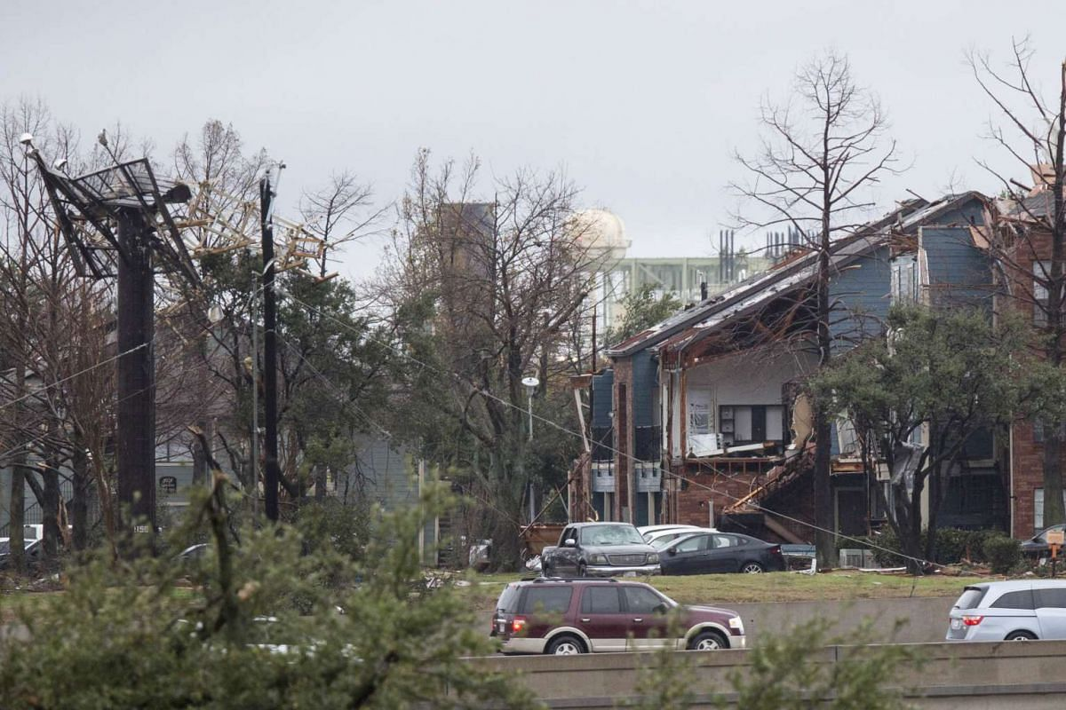 STORM IN US: A heavily damaged house is seen after a tornado tore through Garland, Texas, on Dec 27, 2015.
