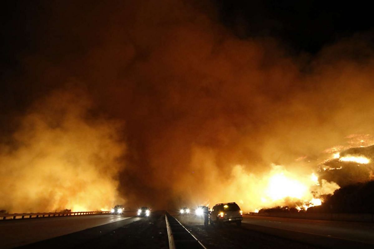 WILDFIRE IN US: The north and south-bound lanes on the Pacific Coast Highway were shut down due to the Solimar brush fire in Ventura County, California, on Dec 26, 2015.