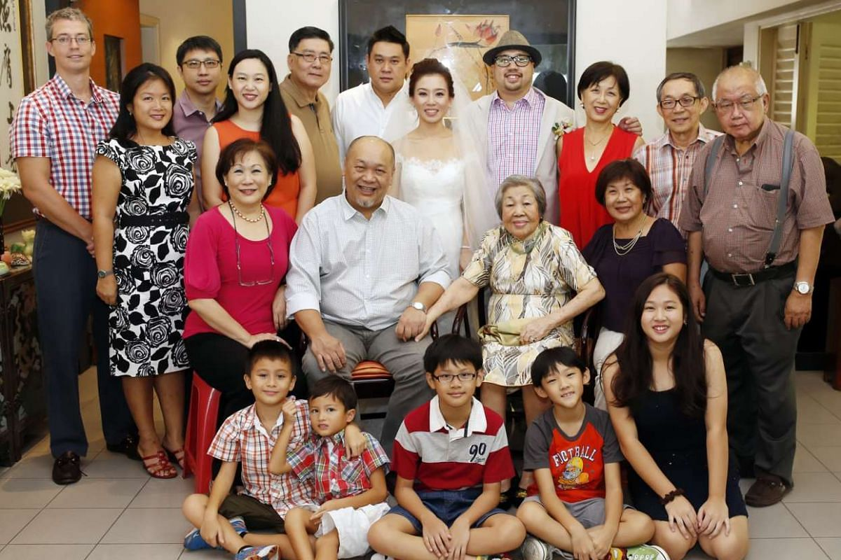 My life so far: Shen and his wife Roxanne with their extended families on their wedding day in November last year.