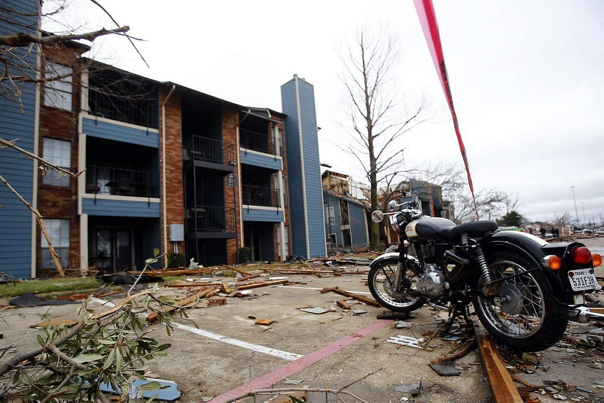 STORM IN US:  A motorcycle sits upright in the parking lot of an apartment complex, in Garland, Texas on Dec 28, 2015.