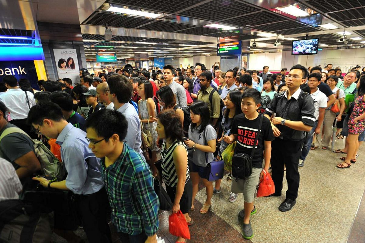 The crowd at City Hall station during the MRT disruption on July 7. The breakdown was caused by intermittent tripping of the rail power system at multiple locations, and crippled services throughout the North-South and East-West lines for more than t