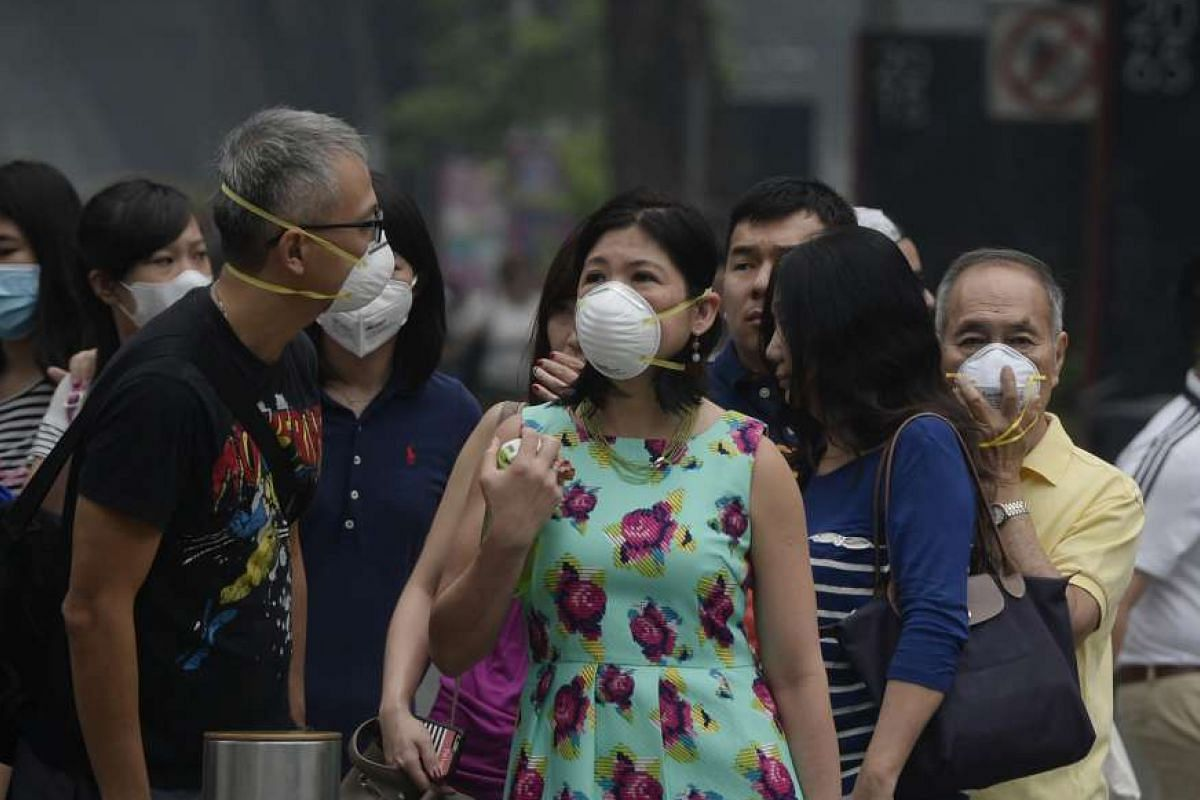 People wearing masks in Orchard Road on Sept 24. All primary and secondary schools here were shut the following day.