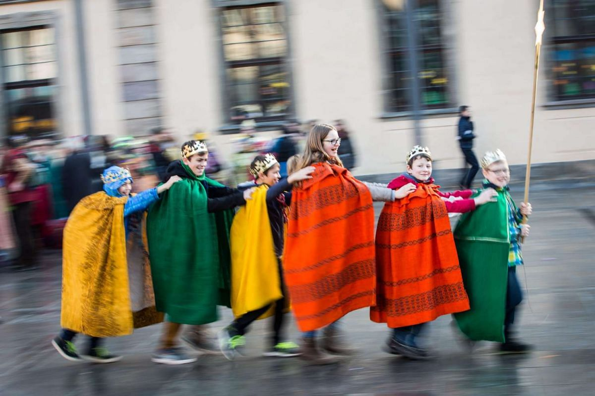 Star singers from St George parish in Poppenhausen make their way through the city centre to collect money for good causes during the nationwide opening of the 58th Dreikoenigssingen (Three kings star singing) in Fulda, Germany, on Dec 29, 2015.