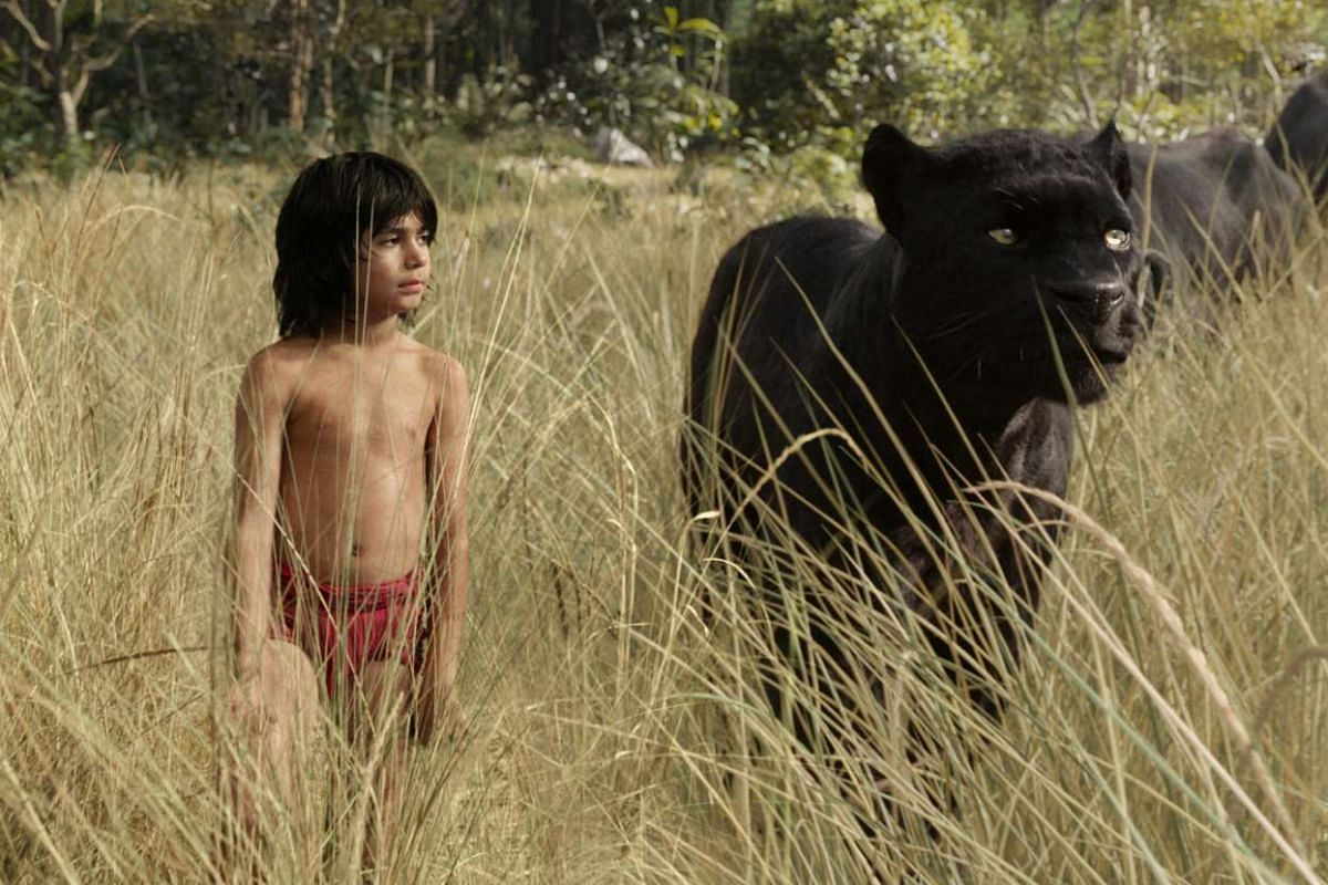 Neel Sethi (left) and black panther Bagheera (right, voiced by Ben Kingsley).