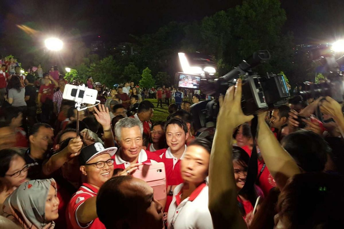 The cameras come out as PM Lee mingles with the crowd.