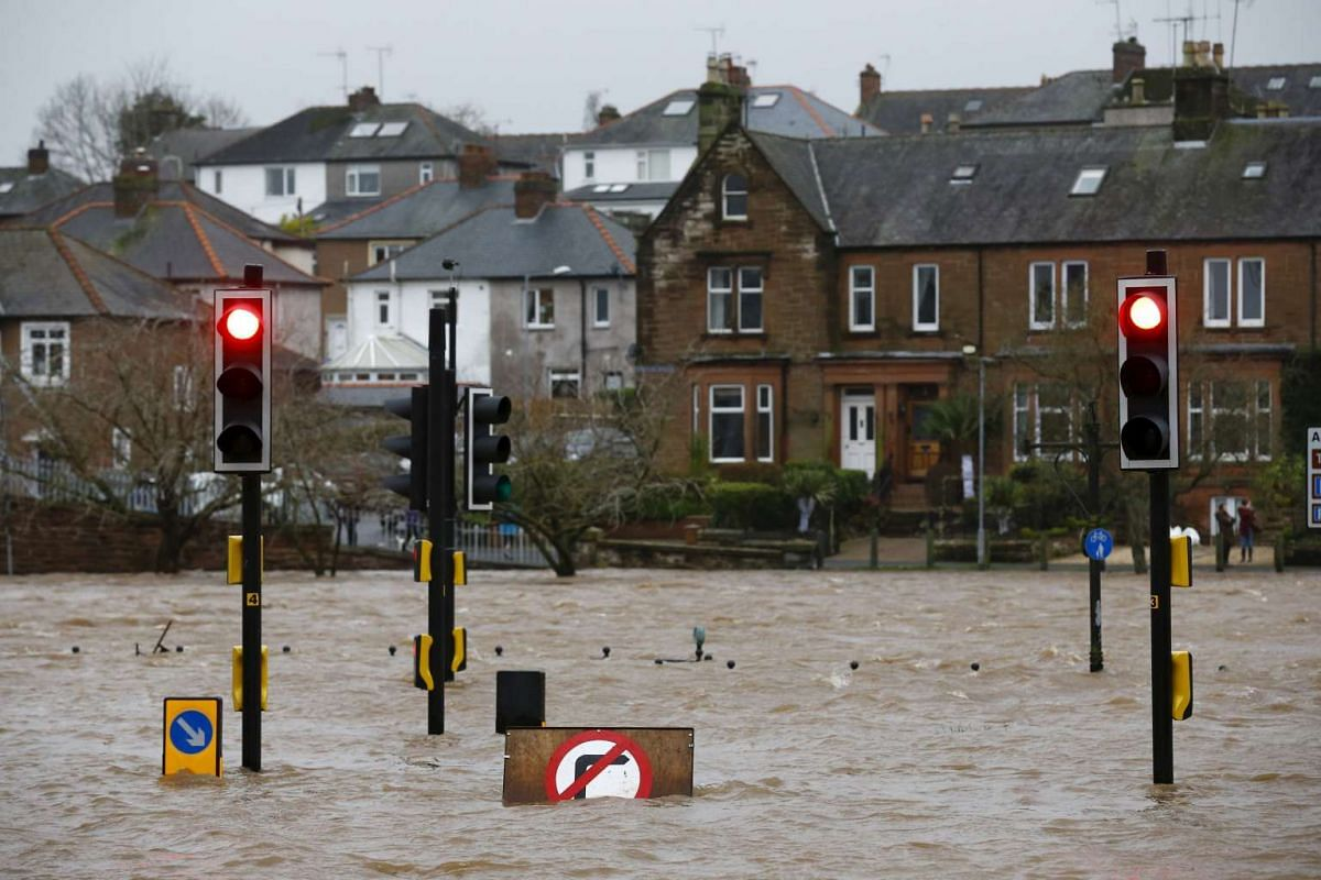 A flooded street is pictured in Dumfries, Scotland on Dec 30.
