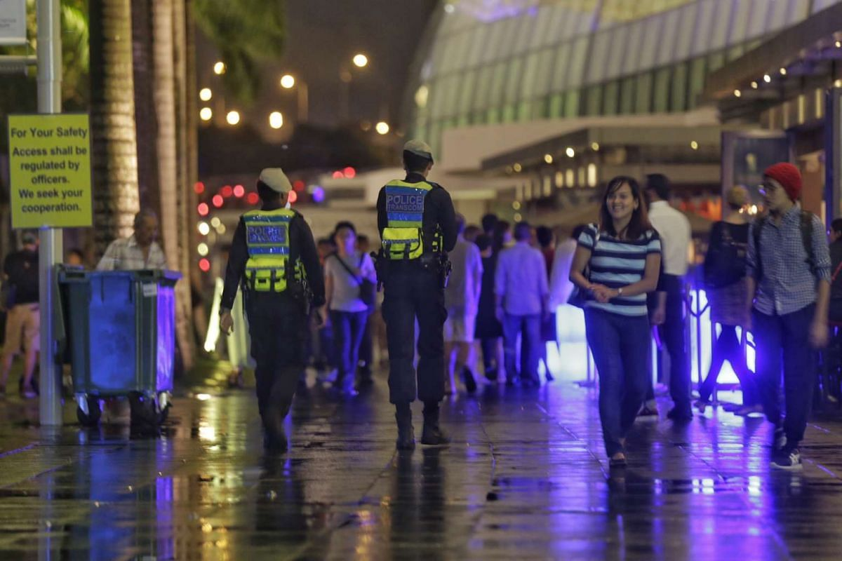 Police officers patrolling the promenade of Marina Bay Sands on Dec 31, 2015.