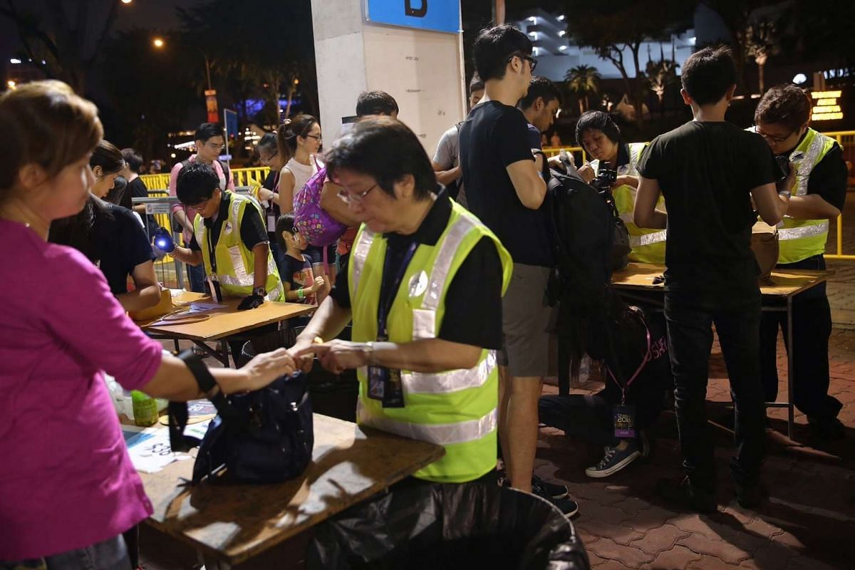 Security personnel checking the bags of members of the public at the Marina Bay Floating Platform.