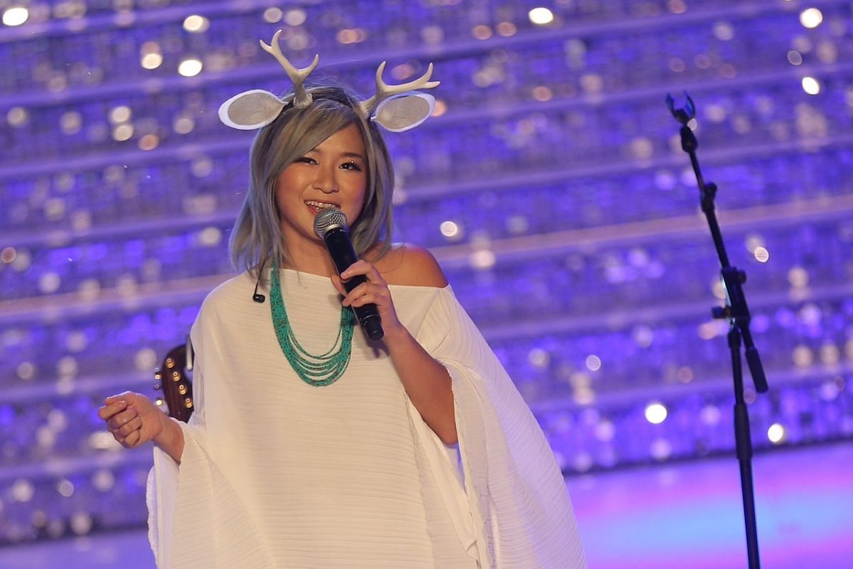 Singer Inch Chua performing dressed like a mouse deer.