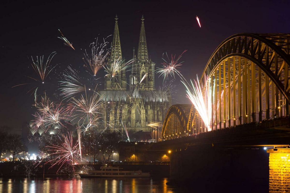 Fireworks fill the sky over the Cologne cathedral, the river Rhine and the old city of Cologne, Germany on Jan 1, 2016.