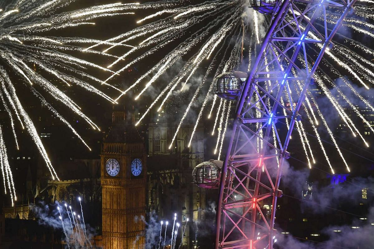Fireworks explode around the London Eye wheel, the Big Ben clock tower and the Houses of Parliament to mark the beginning of the New Year in London, Britain on Jan 1, 2016.