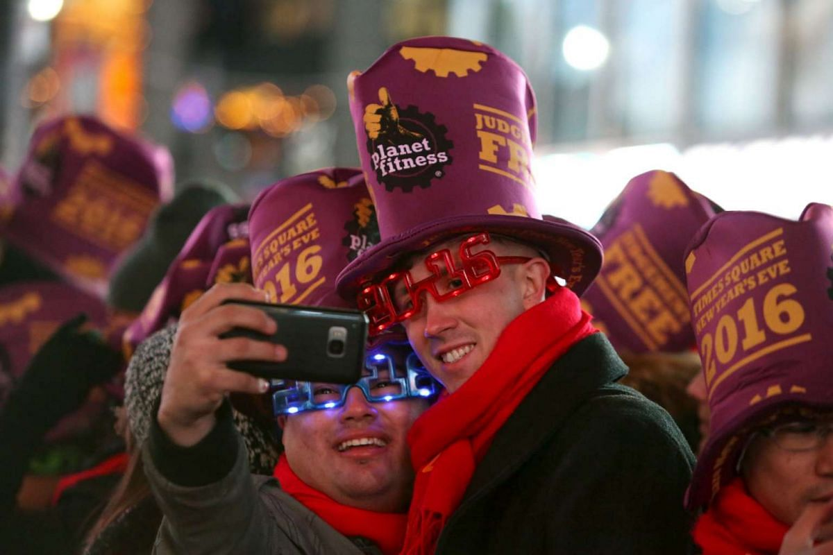 People take a selfie during the New Year celebrations in Times Square in the Manhattan borough of New York on Dec 31, 2015.