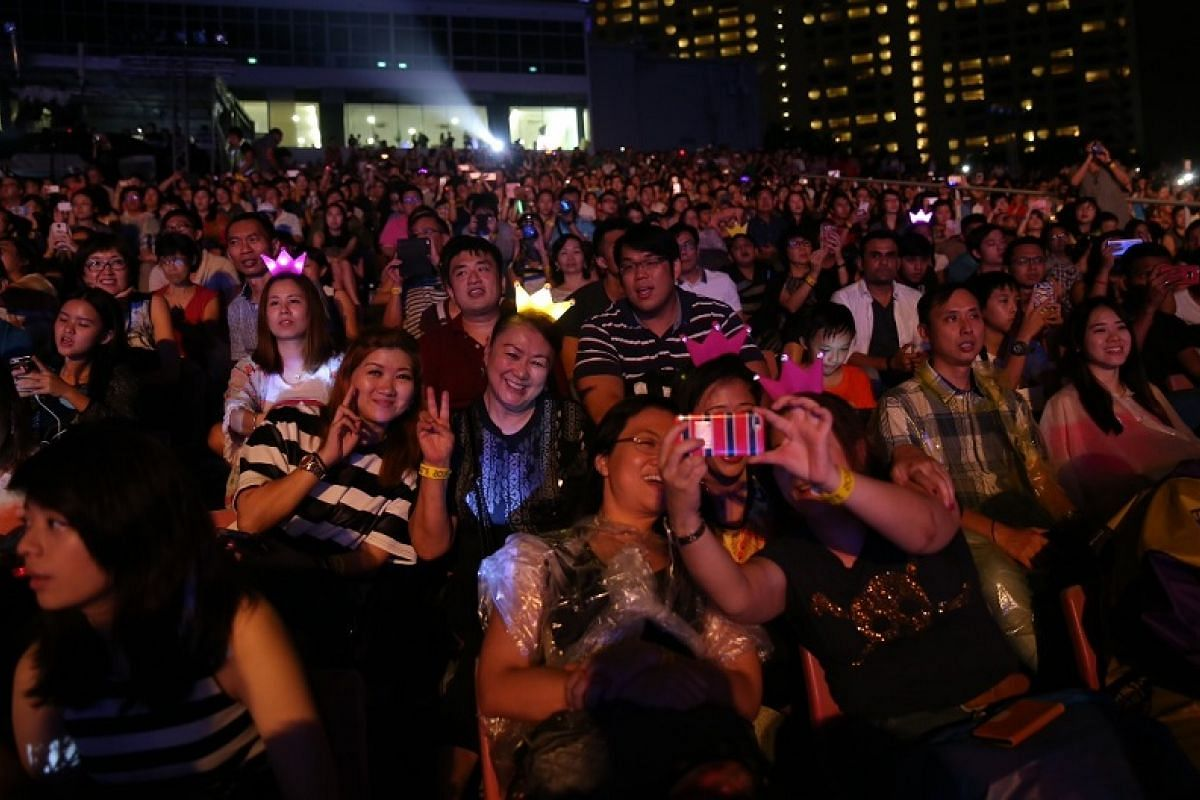 The crowd watches Adam Lambert perform at Celebrate 2016.