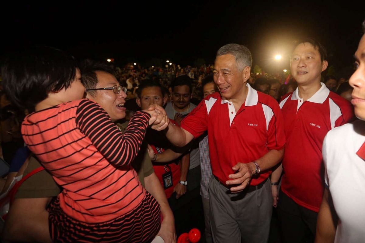 PM Lee and (right) Dr Lam Pin Min greet residents.