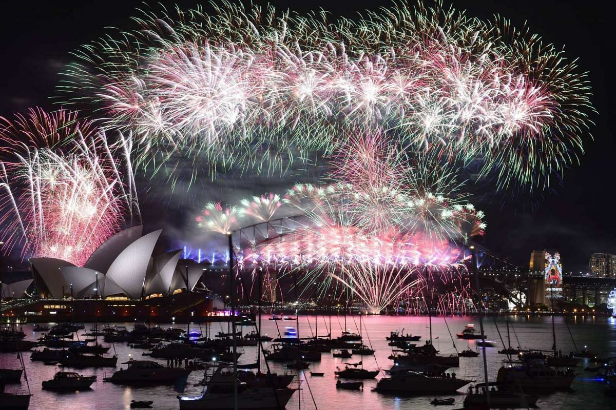 Fireworks light up the sky over Sydney's Opera House (left) and Harbour Bridge during New Year celebrations.