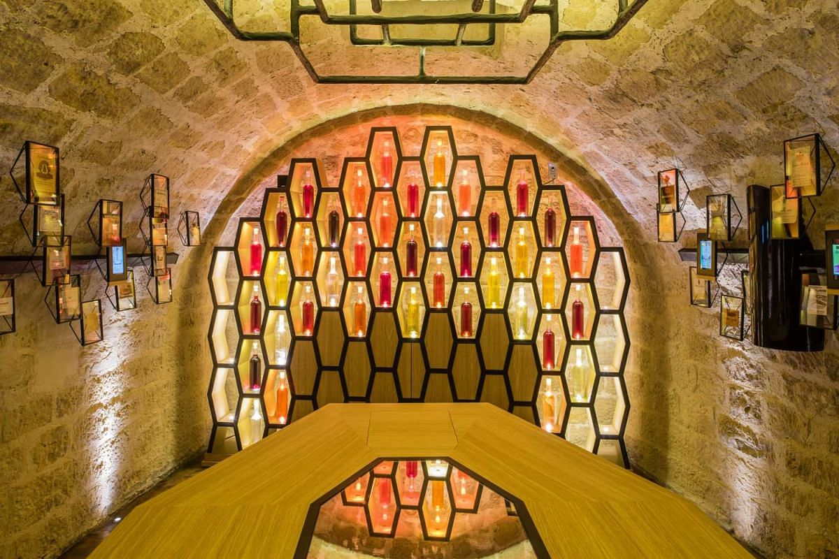 Visitors explore the A to Z of wine through an interactive experience at Les Caves du Louvres (above).