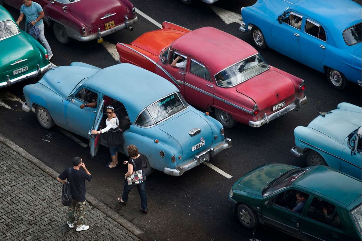Colourful 1950s convertibles ply the streets of Havana in Cuba.