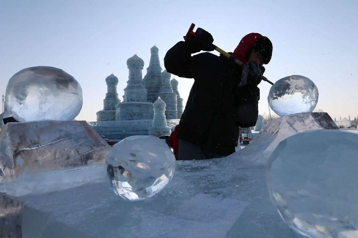 A worker carves an ice sculpture at Harbin Ice and Snow World one day before the 32nd Harbin International Ice and Snow Festival on Jan 4, 2016.