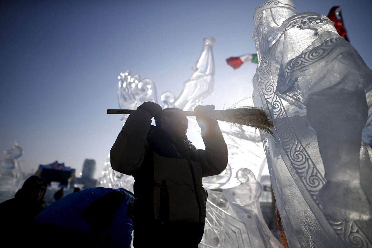 A worker polishes an ice sculpture ahead of the Harbin International Ice and Snow Festival on Jan 4, 2016.
