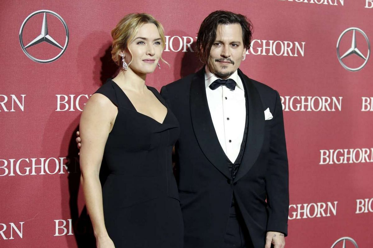 Desert Palm Achievement Award recipient actor Johnny Depp and actress Kate Winslet at the 27th Annual Palm Springs International Film Festival Awards Gala in Palm Springs, California, on Jan 2, 2016.