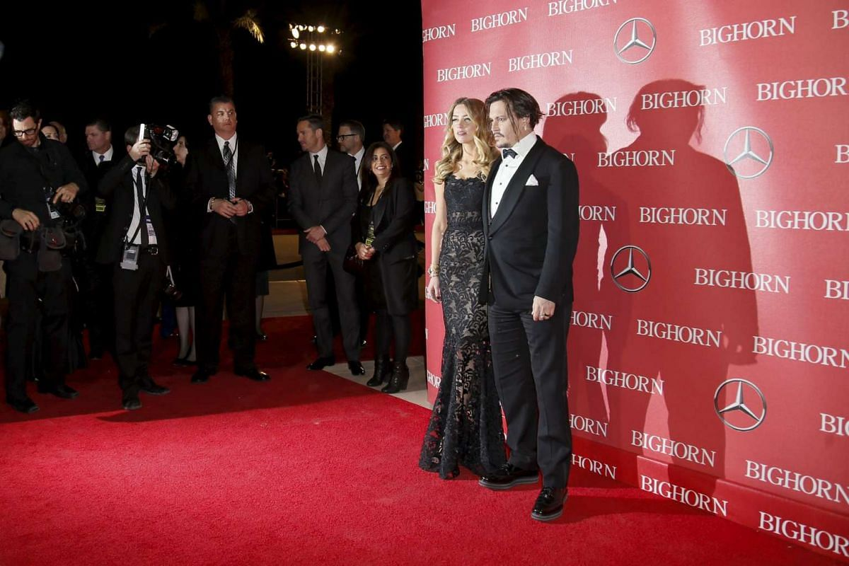 Desert Palm Achievement Award recipient actor Johnny Depp and his wife, actress Amber Heard, posing at the 27th Annual Palm Springs International Film Festival Awards Gala in Palm Springs, California, on Jan 2, 2016.