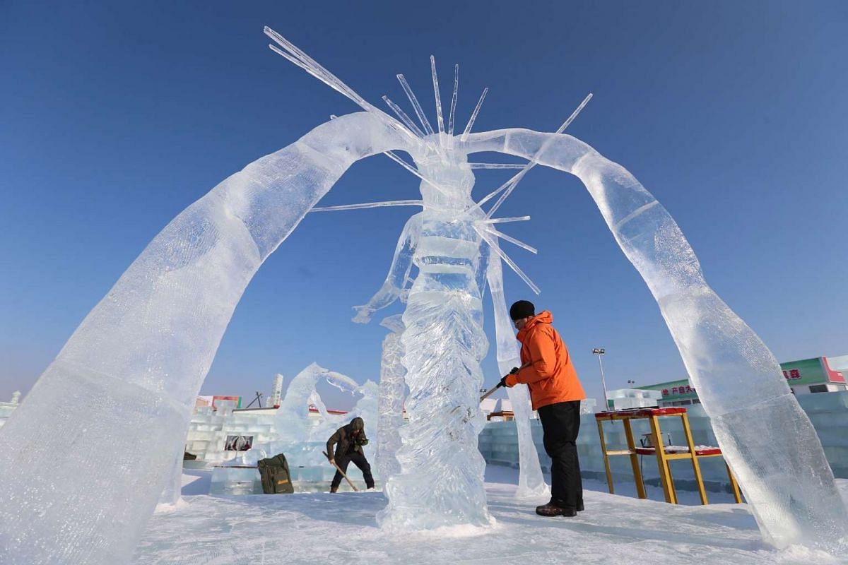 Workers carve ice art works at Harbin Ice and Snow World one day before the 32nd Harbin International Ice and Snow Festival on Jan 4, 2016.