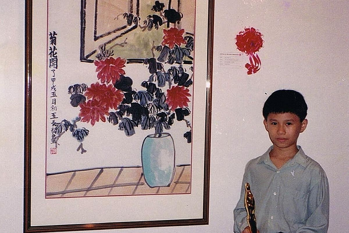 My life so far: Chen Zhangyi at age three and with the UOB Painting of the Year Young Artist Award (above) when he was 10 years old.