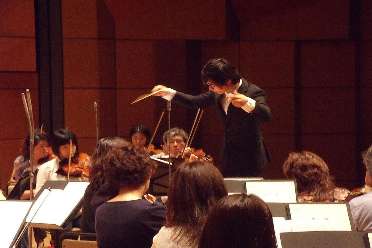My life so far: Chen conducting Rain Tree (above) with the Tokyo Philharmonic Orchestra in 2011 and with composer-conductor Eric Whitacre at Abbey Road Studios in London, where his work for orchestra and chorus, Ariadne's Love, was recorded by the London