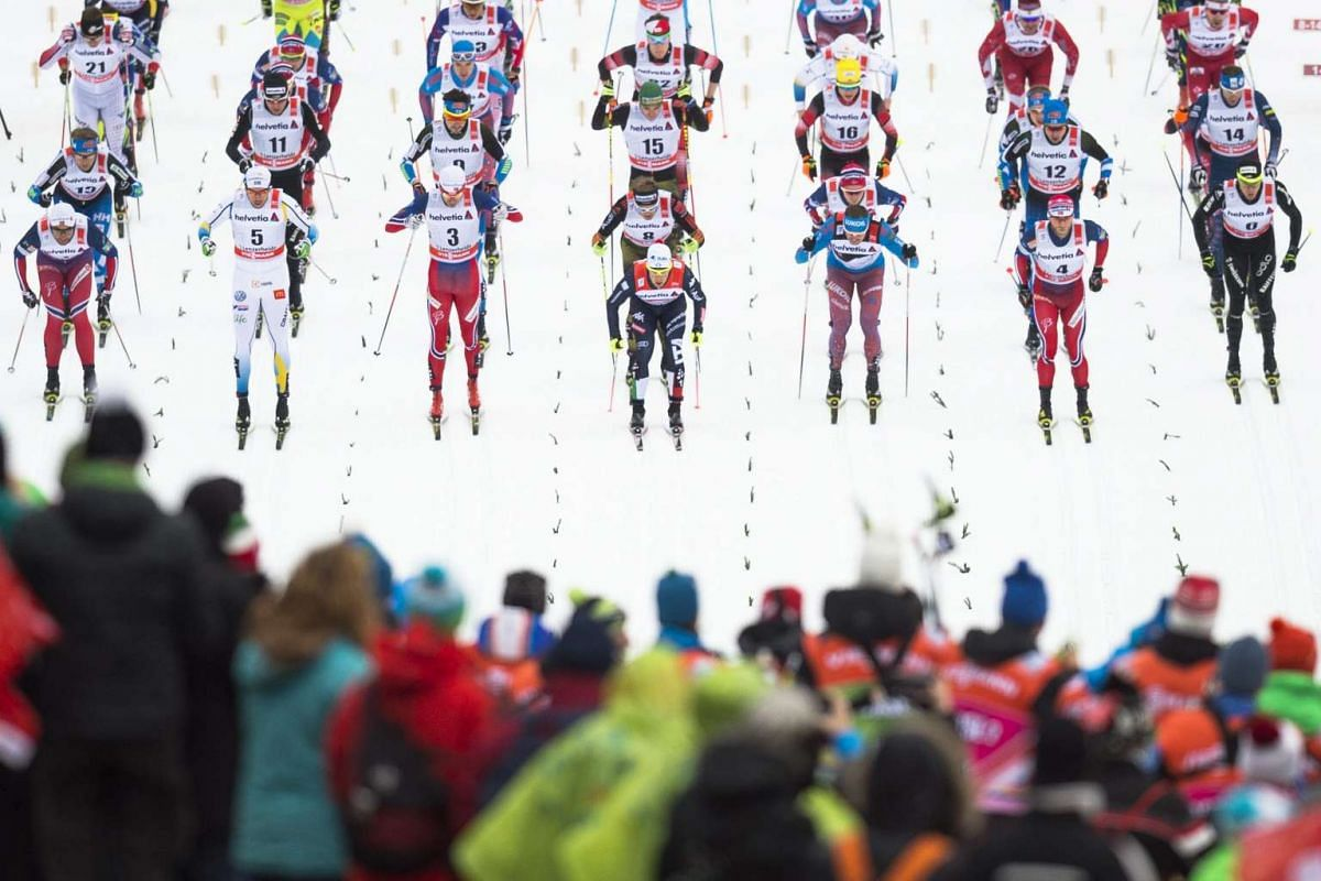 Participants starting the men's 30km cross-country skiing pursuit race at the FIS Tour de Ski on Jan 2, 2016, in Lenzerheide, Switzerland.