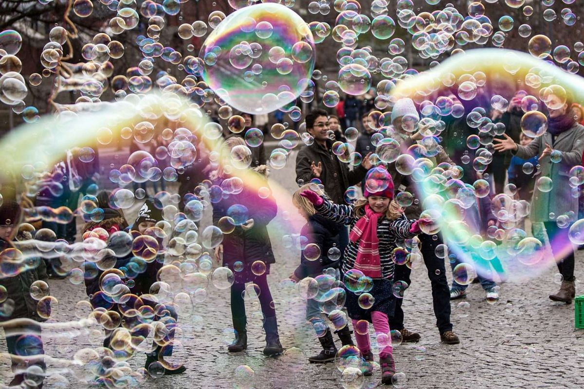 Visitors and children playing with bubbles in Cologne, Germany, on Jan 3, 2016.