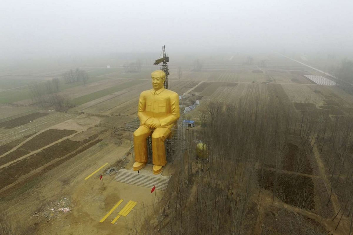 A giant statue of Chinese late chairman Mao Zedong under construction near crop fields in a village in Henan province, China on Jan 4, 2016.