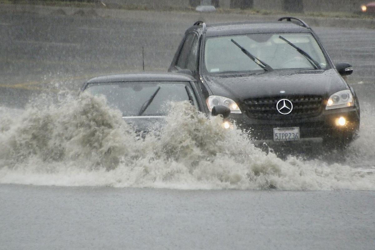 Vehicles on a flooded road in Van Nuys, California, on Jan 5.