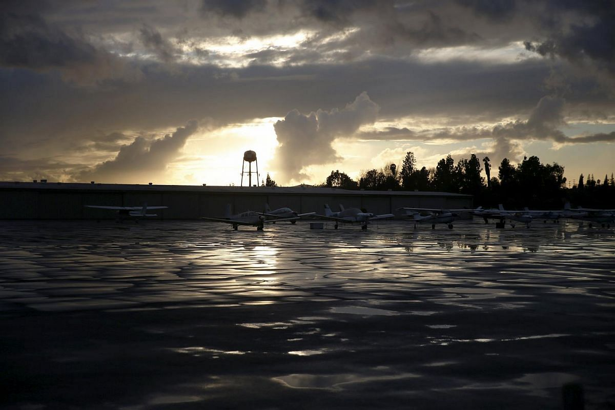 Puddles and storm clouds are seen at an airfield after a storm in El Monte, California, on Jan 5.