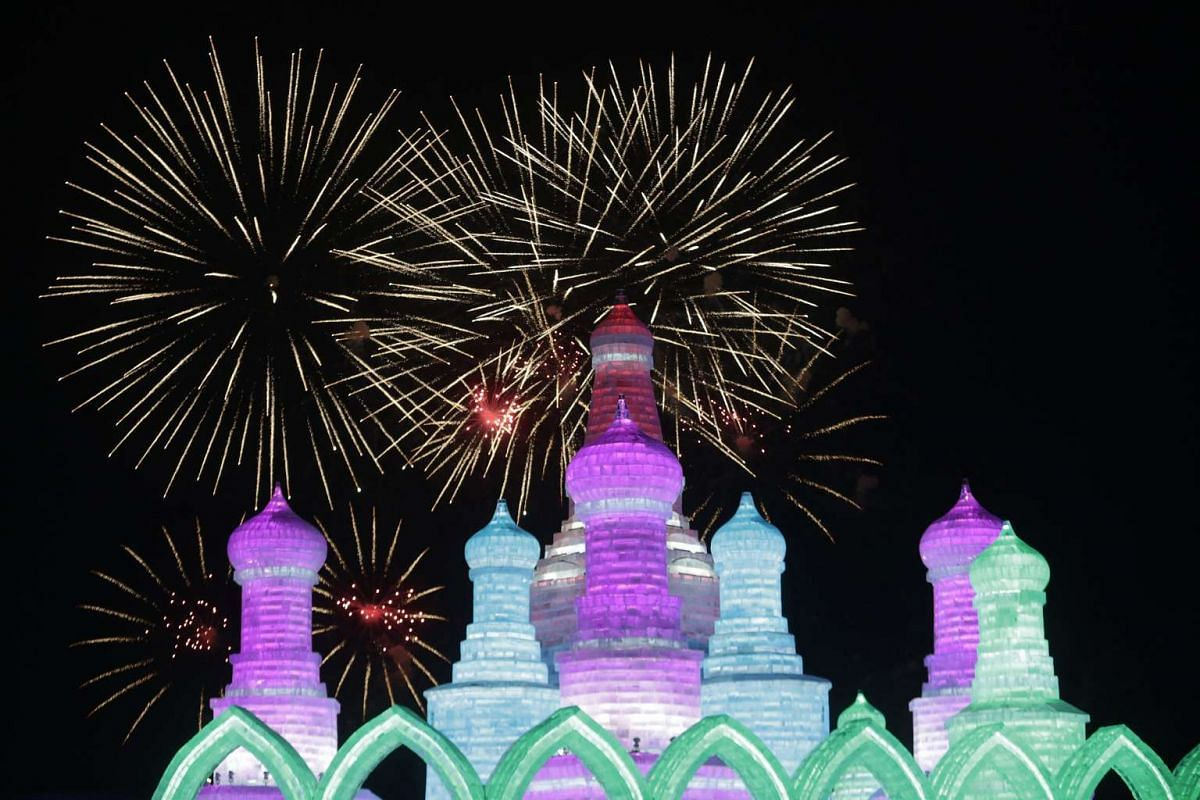 Fireworks lighting up behind ice sculptures during the Harbin International Ice and Snow Festival in Heilongjiang province, China on Jan 5, 2016.