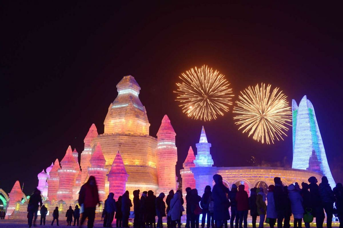 Crowds gathering to catch a fireworks display at the Harbin International Ice and Snow Festival on Jan 5, 2016.