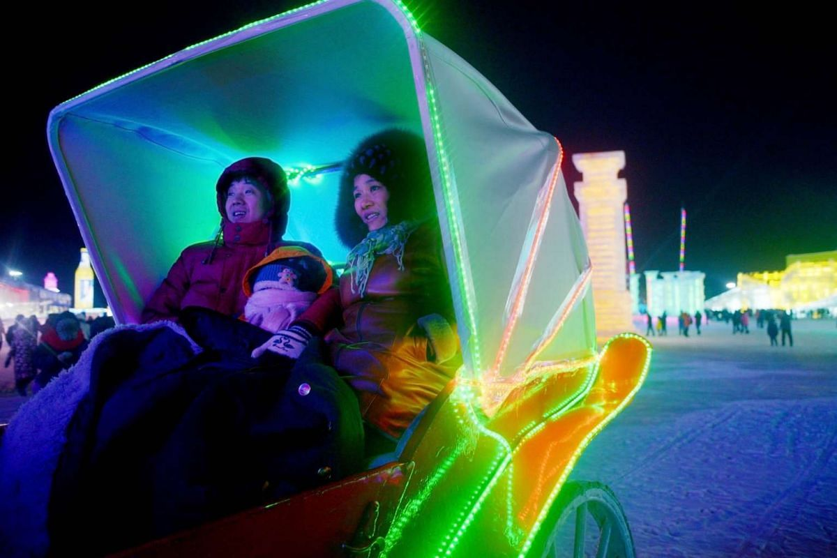 A family enjoying a carriage ride in the China Ice and Snow World in the Harbin International Ice and Snow Festival on Jan 5, 2016.