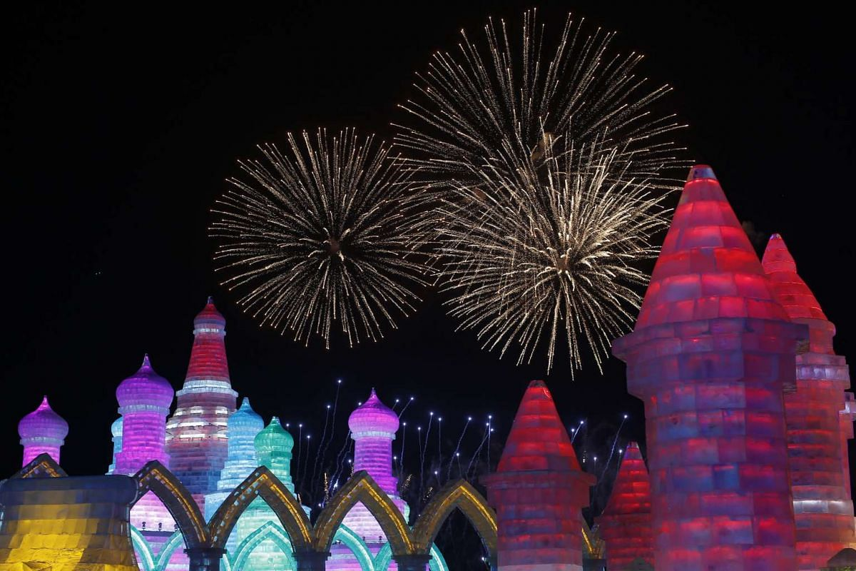 Fireworks lighting up behind ice sculptures on the opening day of the Harbin International Ice and Snow Festival on Jan 5, 2016.