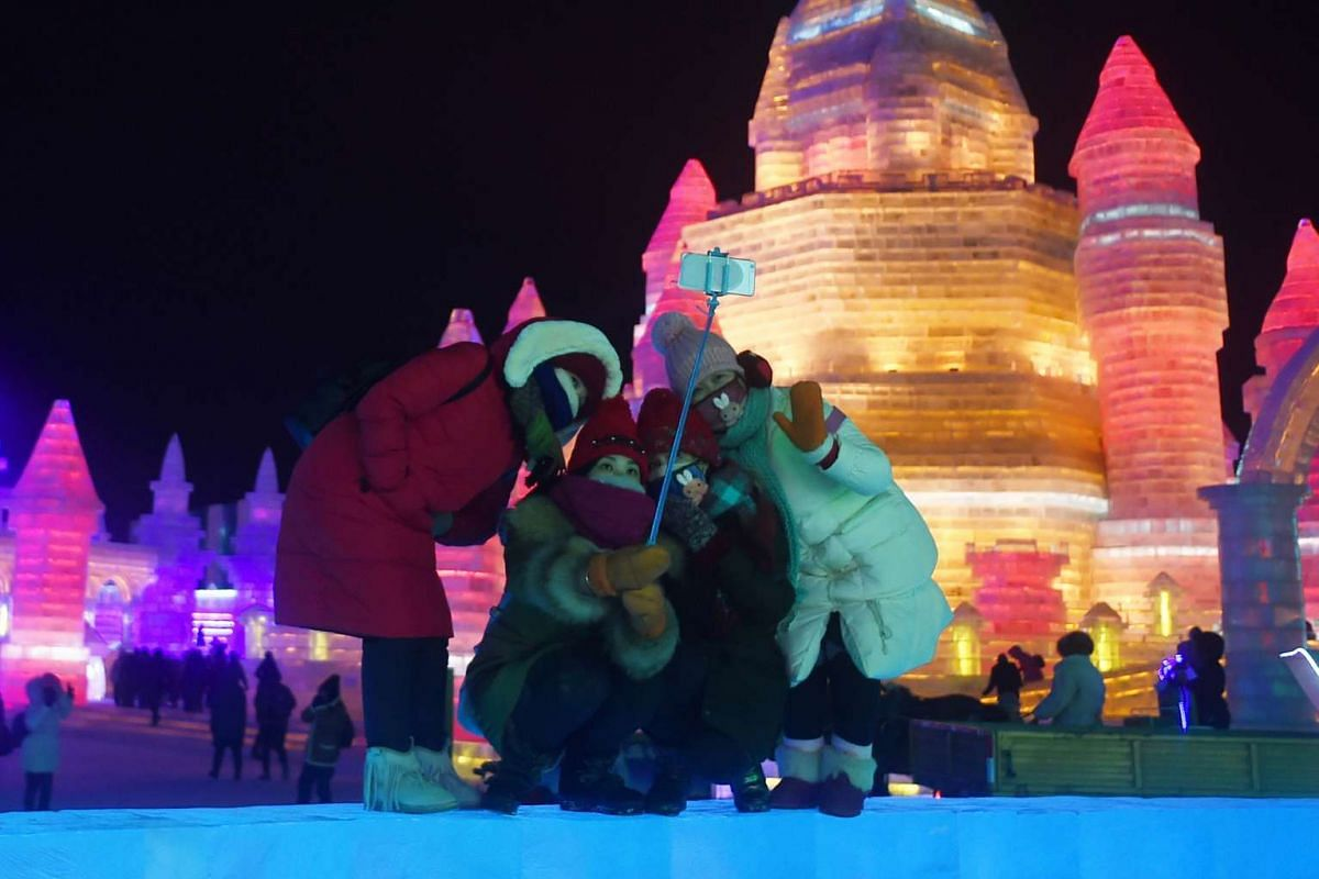 A group of visitors taking a picture at the China Ice and Snow World during the Harbin International Ice and Snow Festival in Harbin on Jan 5, 2016.