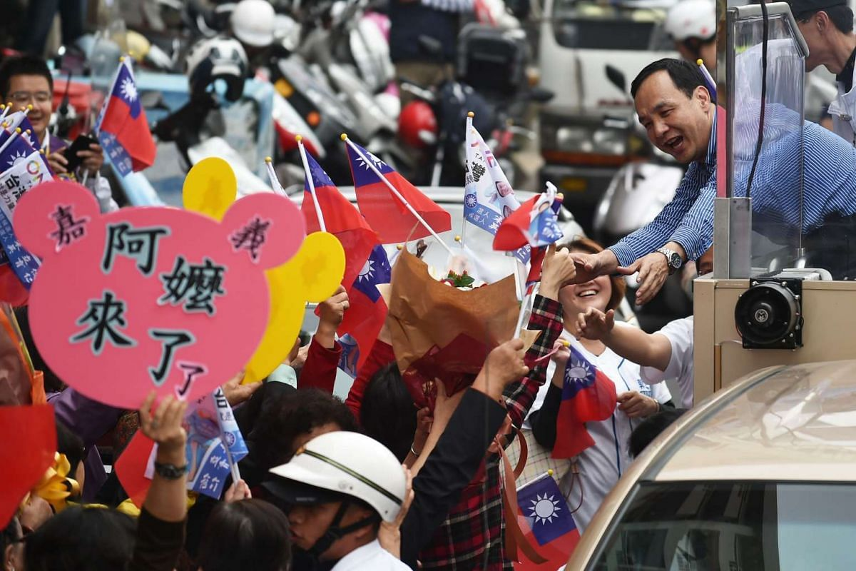 Mr Eric Chu (top right), presidential candidate from the ruling KMT, greeting supporters during an election campaign in Chiayi, southern Taiwan on Jan 5, 2016.