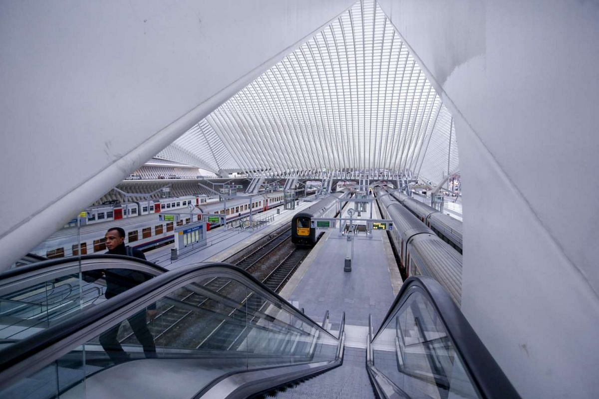 A lone passenger using an escalator to leave a deserted platform at the start of a 48-hour rail strike at Liege's Guillemin train station, Belgium, on Jan 6, 2016.